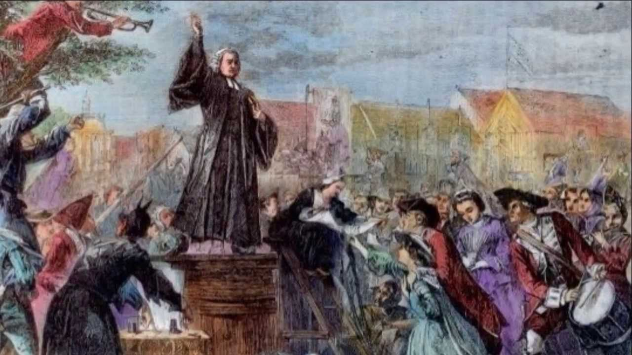 A picture of a man dressed like a judge on a pedestal being crowded around by other onlookers
